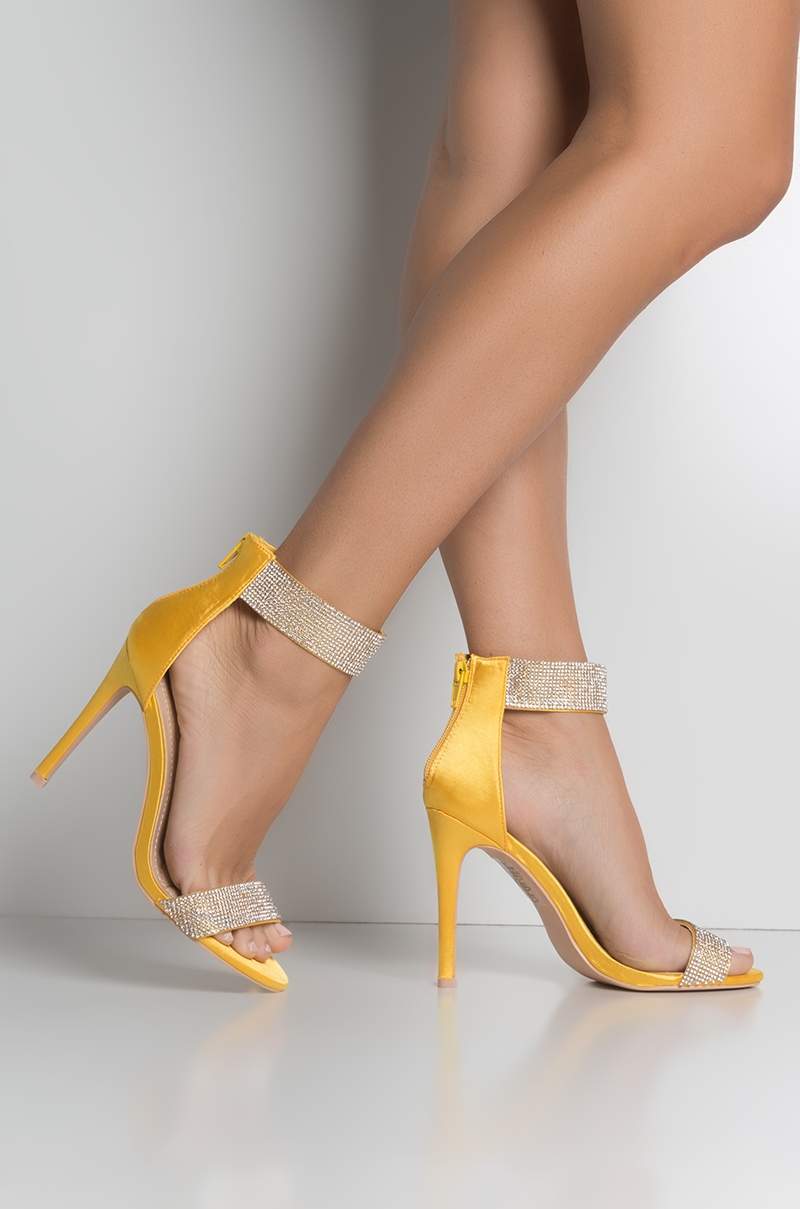 ef79a4688a AKIRA High Stiletto Rhinestone Ankle Strap Zip Up Heel Sandals in Yellow  Satin, Silver,