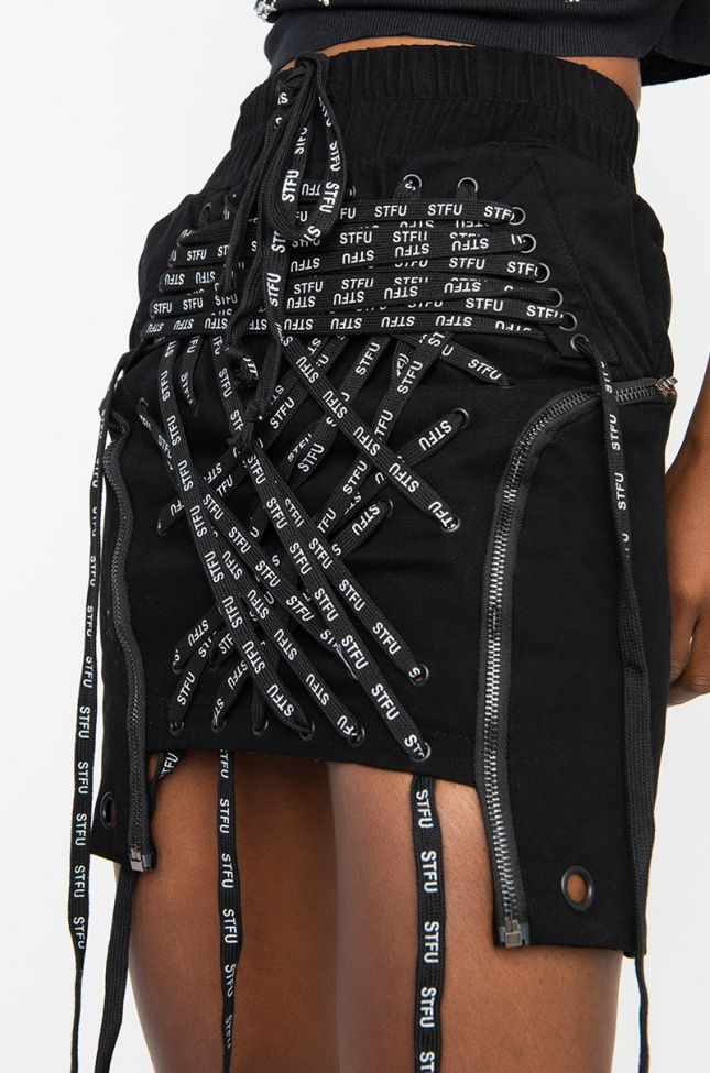 Detail View All Tied Up Lace Front Stretch Mini Skirt in Black