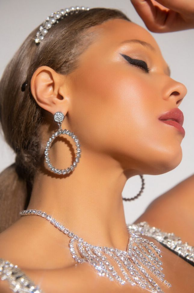 Front View Baby Come Back To Me Rhinestone Dangle Earring in Silver
