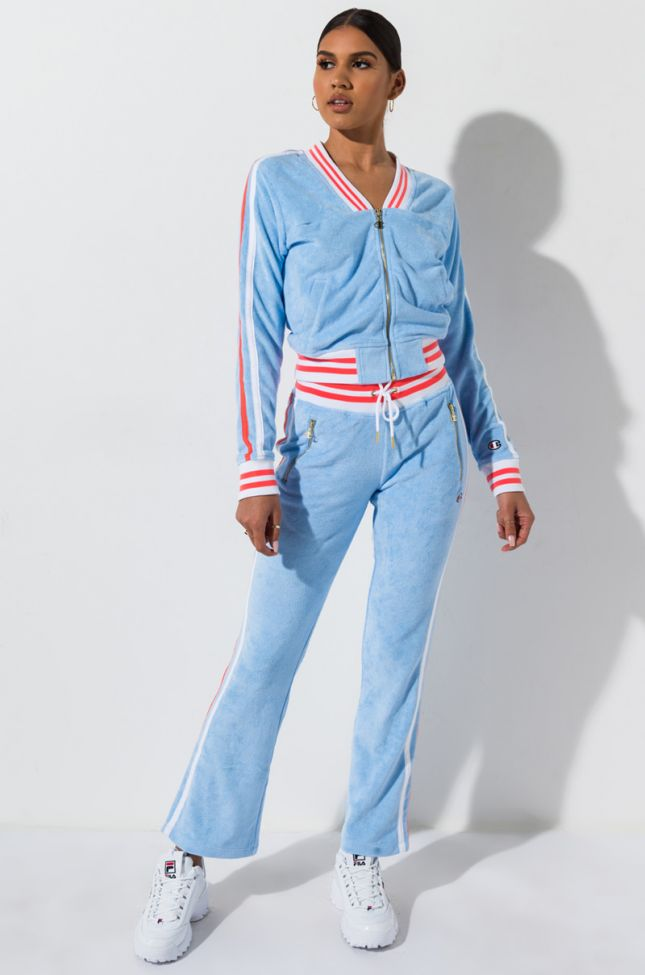 Front View Champion Terry Cloth Warm Up Slim Flare Pant With Small C Logo in Ocean Front Blue