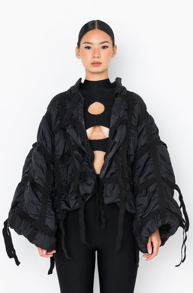 Detail View Drippy Strappy Puffer Jacket