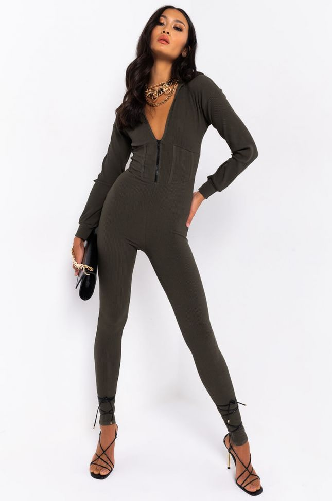 Front View In It To Win Ribbed Jumpsuit in Olive