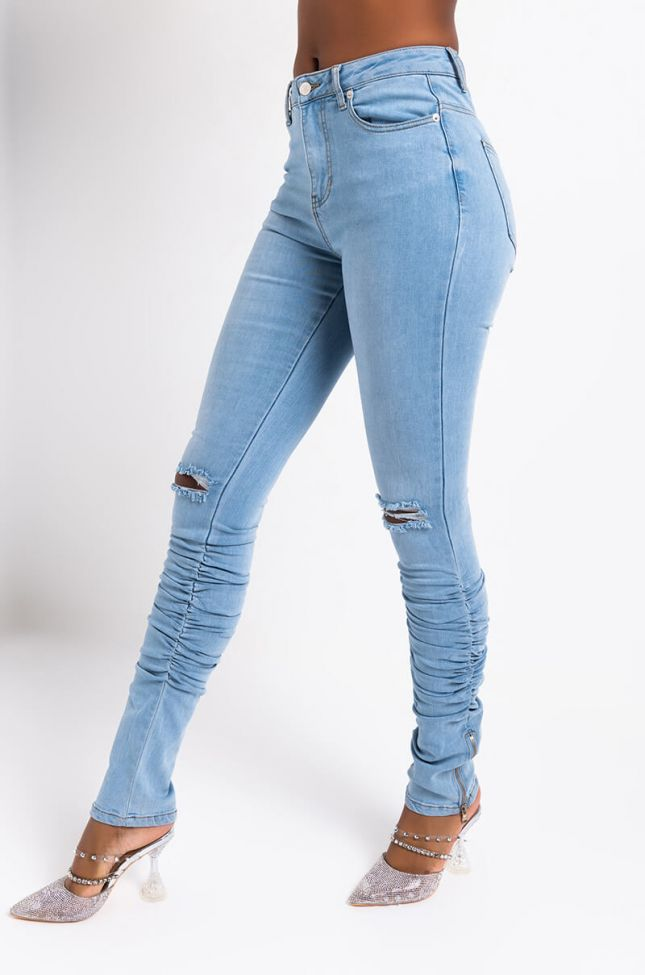 Side View Irina Stacked High Rise Skinny Jeans in Medium Blue Denim