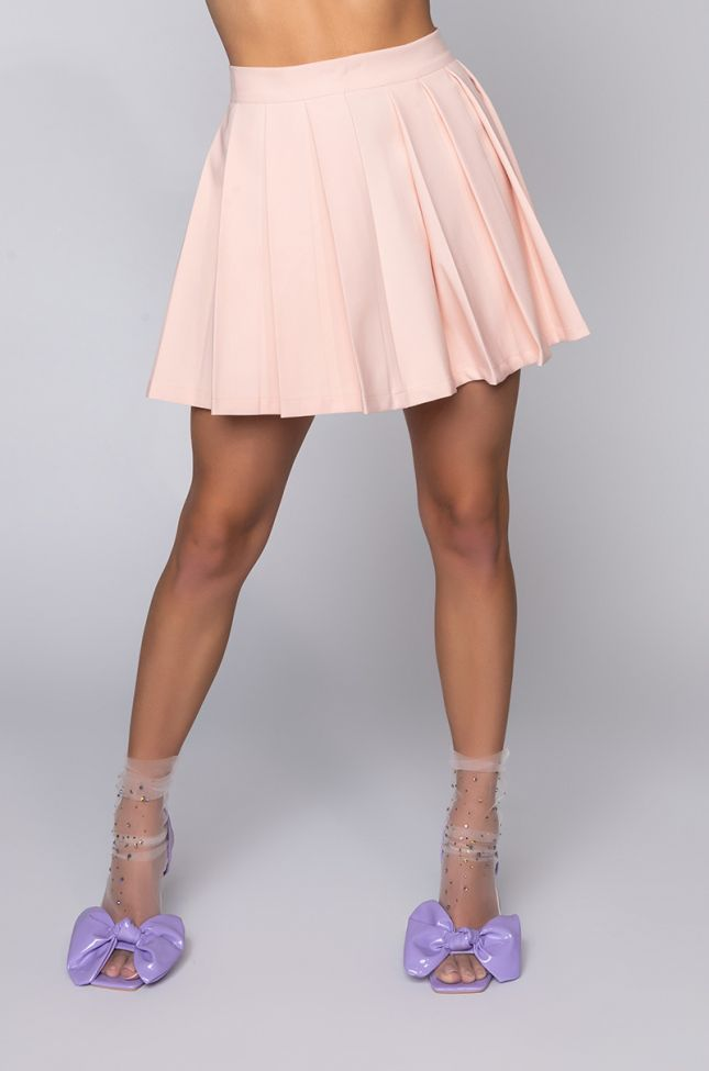 Front View Isle Pleated Mini Skirt in Pink