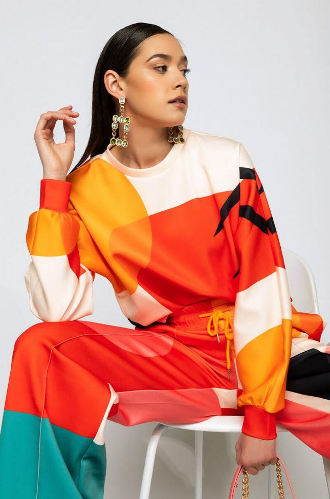 Its A Masterpiece Long Sleeve Sweatshirt in Orange Multi