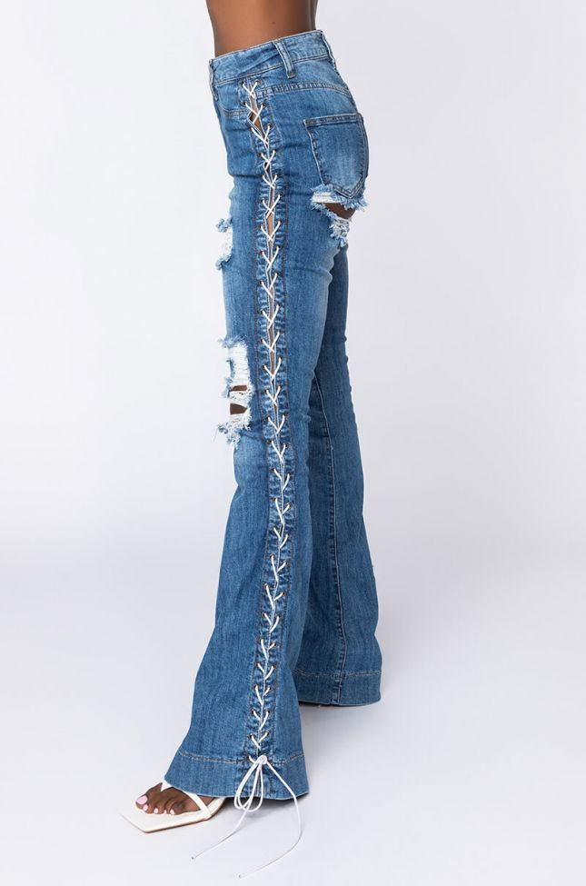 Side View Just A Look Lace Up Flare Jeans in Medium Blue Denim
