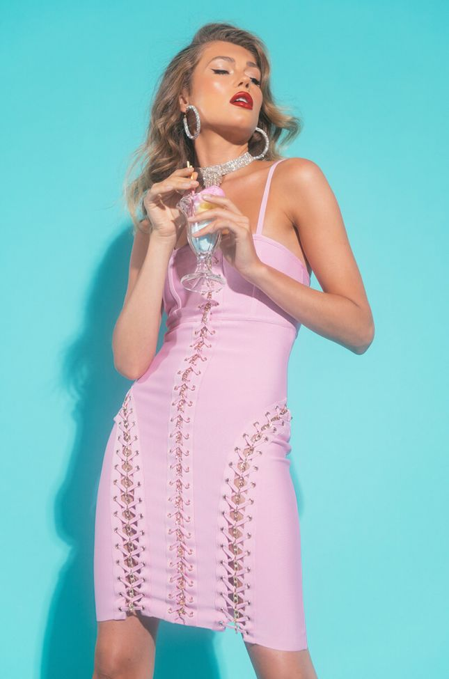 Front View Limited Edition Bandage Knit Mini Dress With Lace Up Gold Chains in Pink