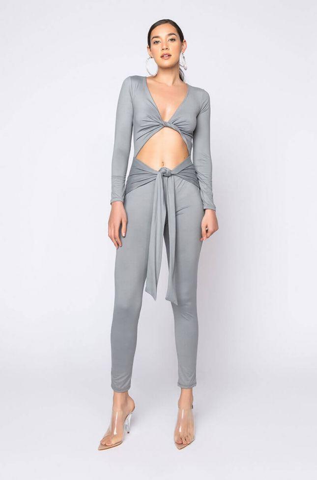 Front View Love Runs Deep Long Sleeve Tie Jumpsuit in Grey