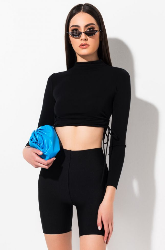 Front View Moving Forward Mock Neck Ruched Long Sleeve Top in Black
