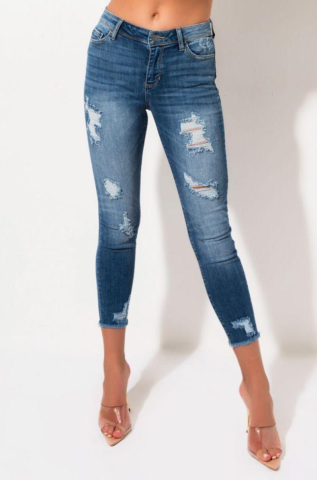 Side View Neptune Mid Rise Skinny Jeans in Medium Blue Denim