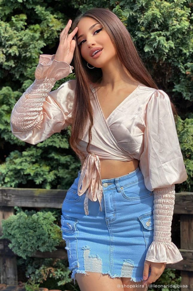 Front View On The Lookout Smocked Long Sleeve Tie Blouse in Light Pink