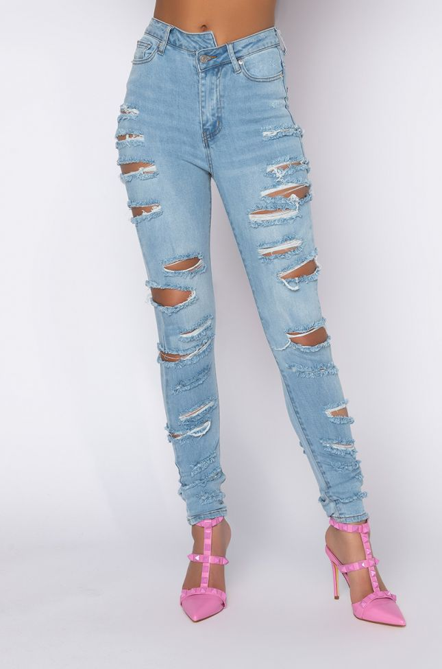 Front View Opposite Direction High Waisted Distressed Skinny Jeans in Light Blue Denim