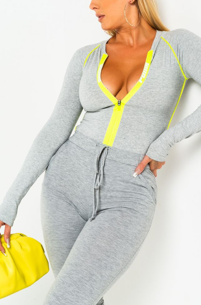 Front View Puma Womens Long Sleeve Bodysuit in Lime