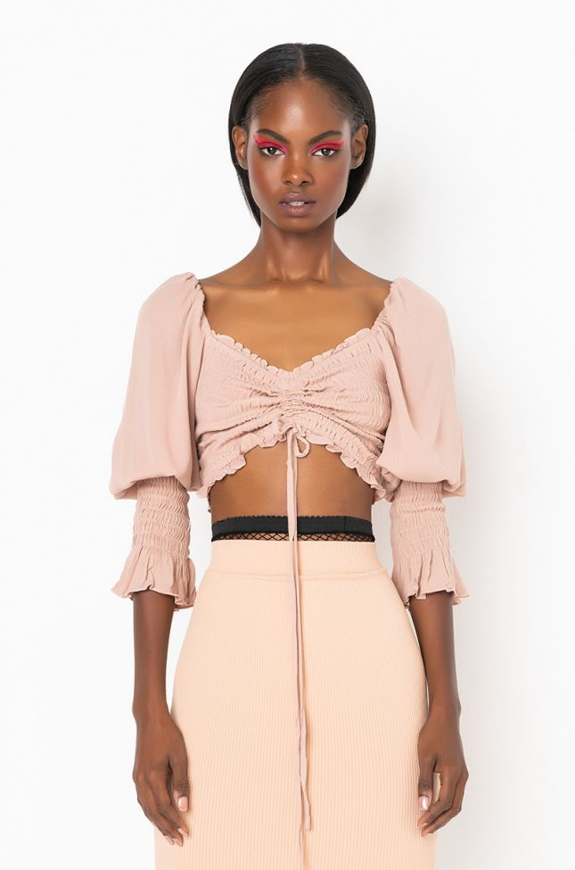 Front View Put Me First Off The Shoulder Smocked Long Sleeve Crop Top in Taupe