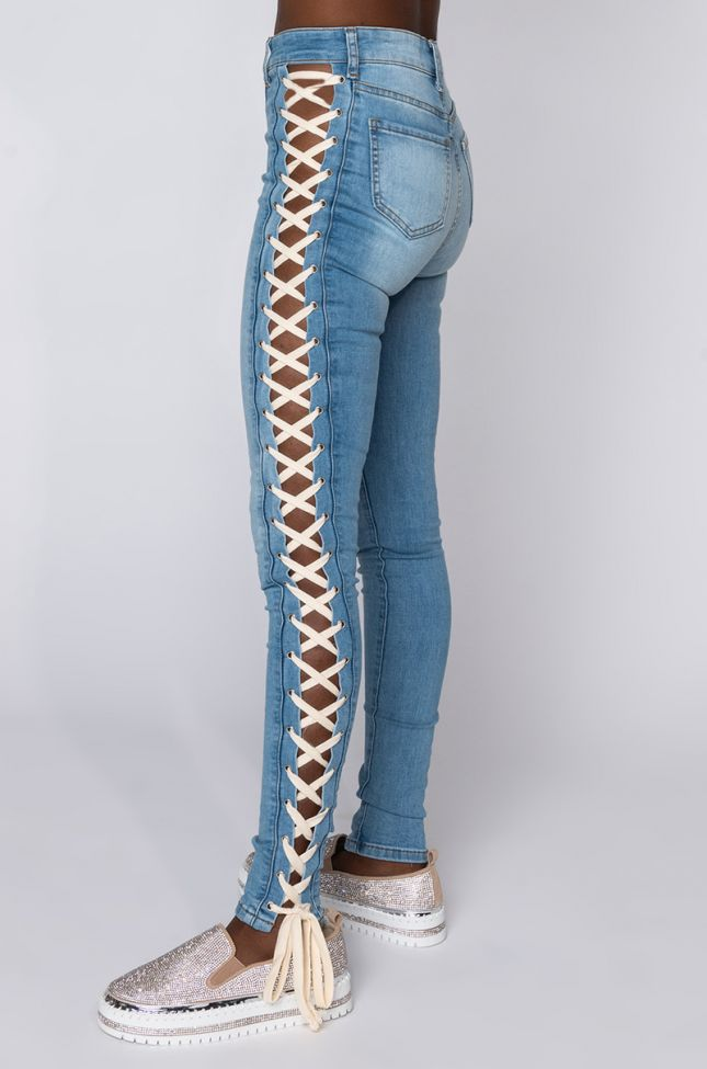 Side View Rock The Runway Lace Up Skinny Jeans in Light Blue Denim
