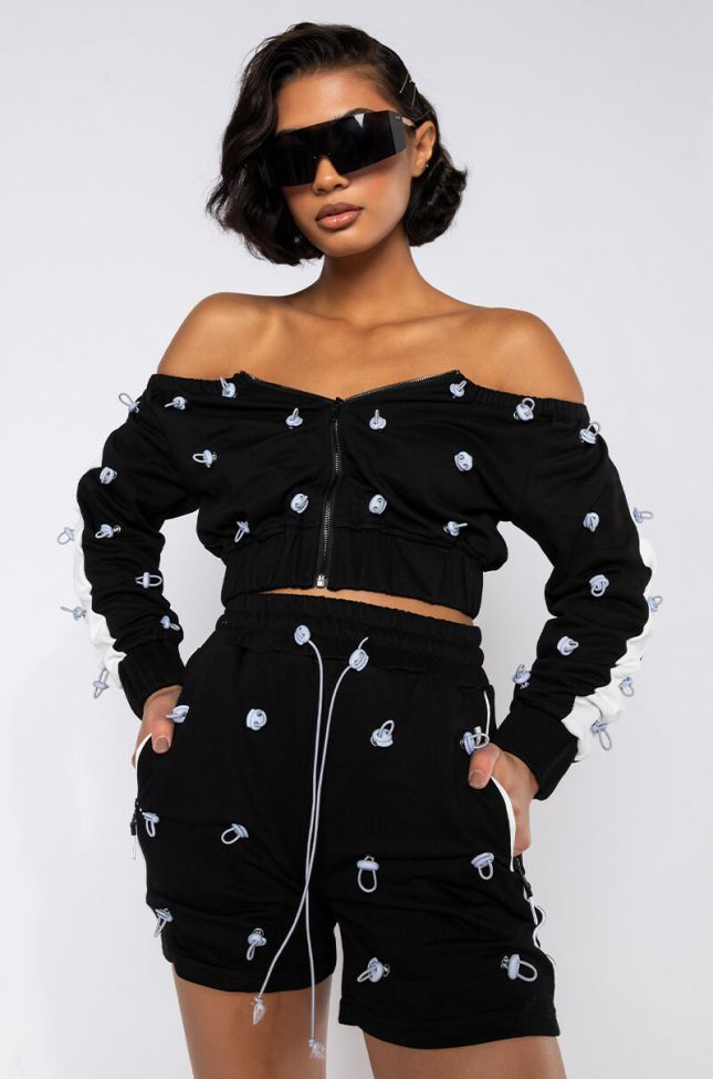 Front View That Bounce Back Off The Shoulder Zip Up Top in Black