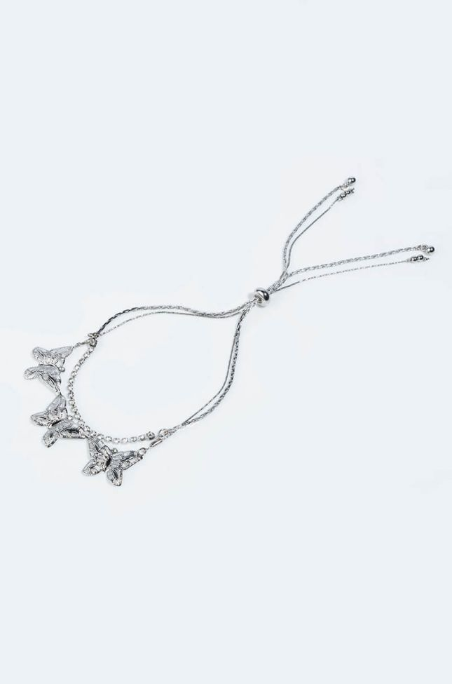 THE BUTTERFLY EFFECT RHINESTONE AND BUTTERFLY STATEMENT BRACELET