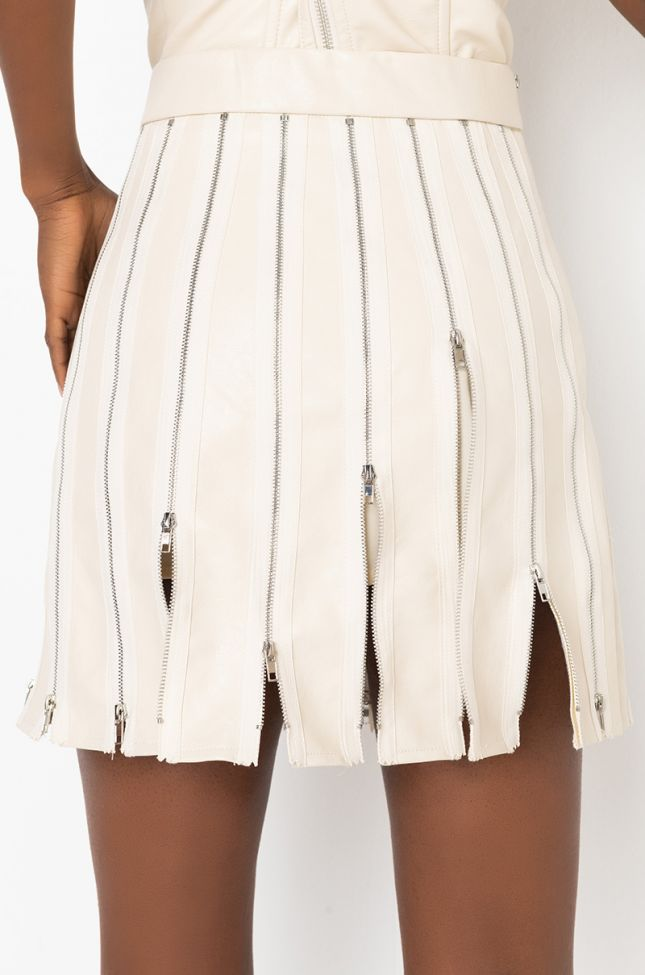 Detail View Tiana Pu Zipper Detail Mini Skirt in Ivory