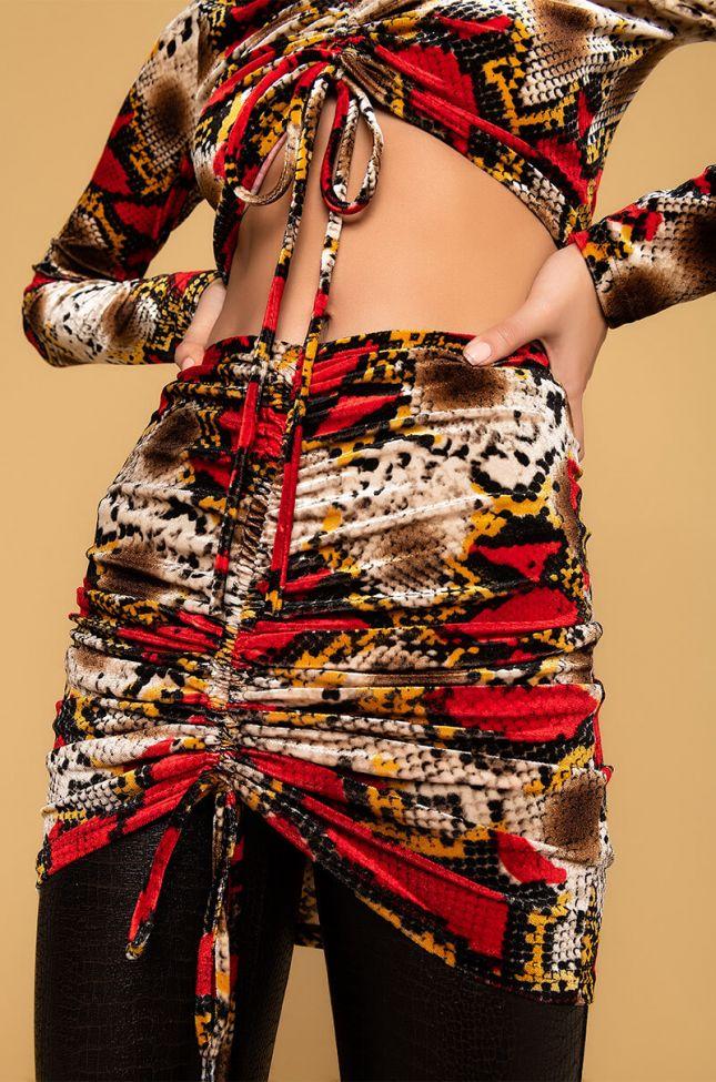Detail View Whats Poppin Velvet Snake Print Ruched Skirt in Red Multi