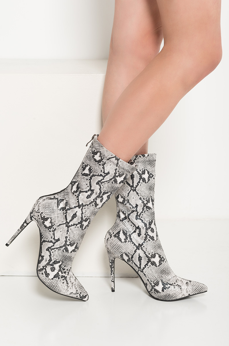 5efc234d393 AKIRA High Stiletto Heel Zip Up Pointed Toe Glimmer Faux Snakeskin Booties  in Black White Snake