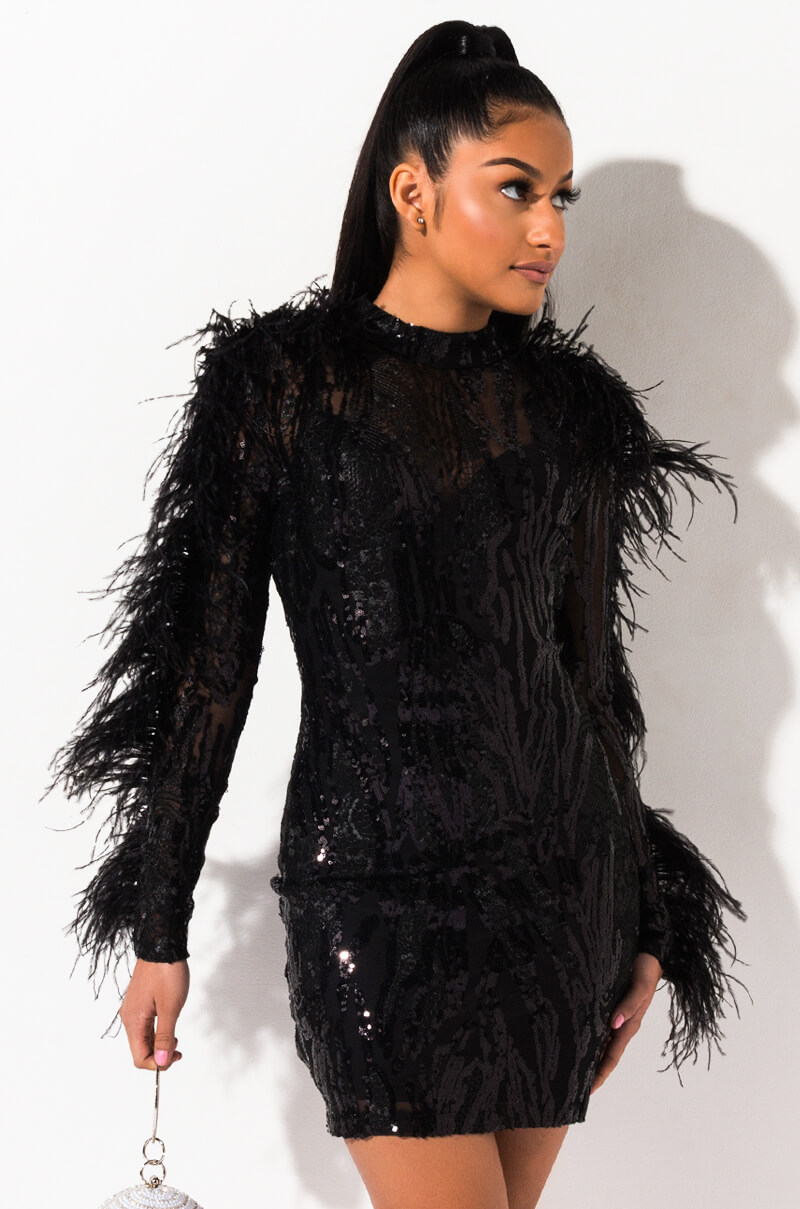 AKIRA Label Sheer Sequin and Feather Embellished Sheer Mini Dress in Black