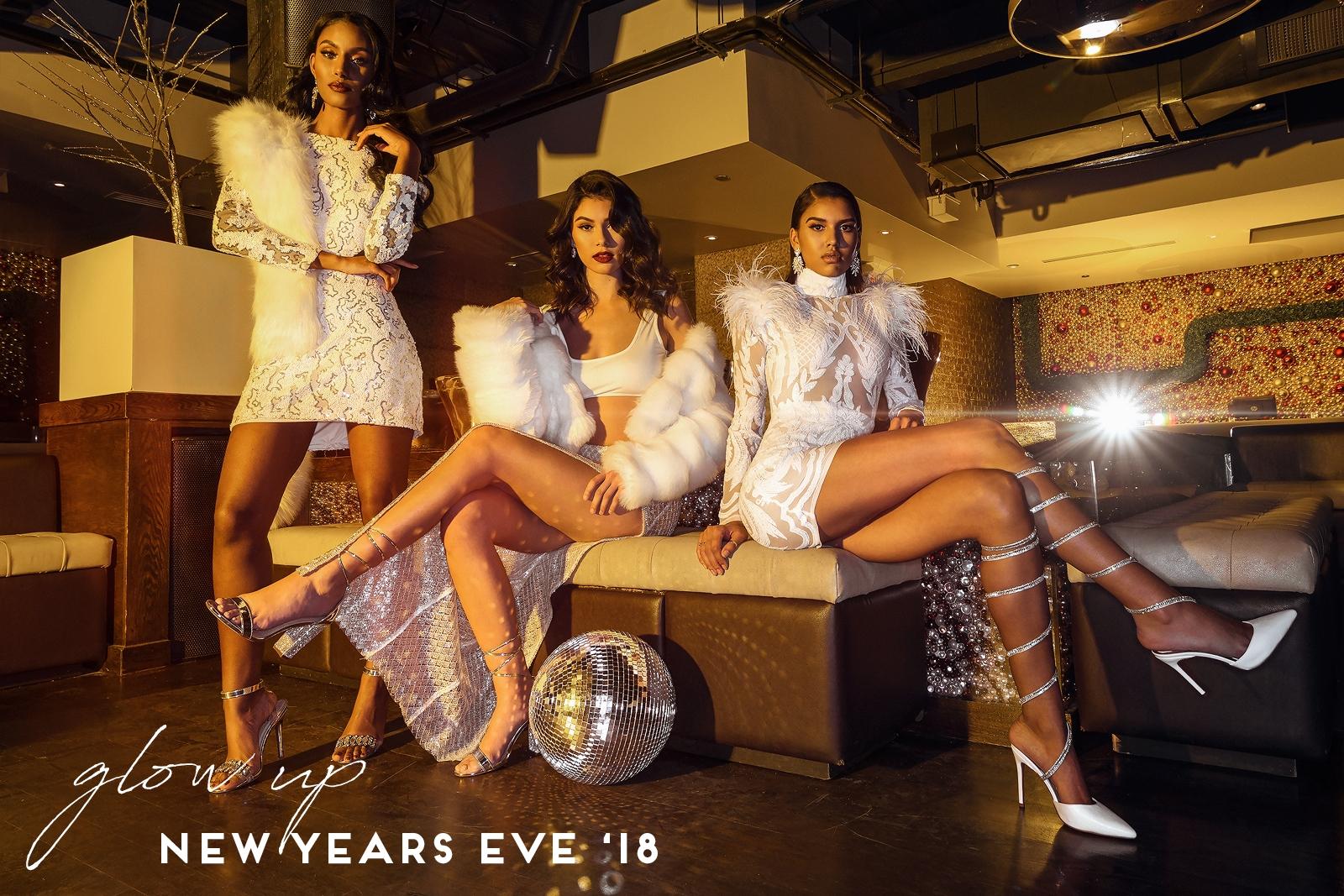 all models sitting in white dresses